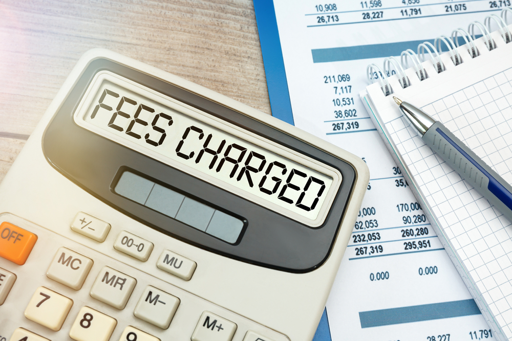 the words FEES CHARGED typed on calculator.