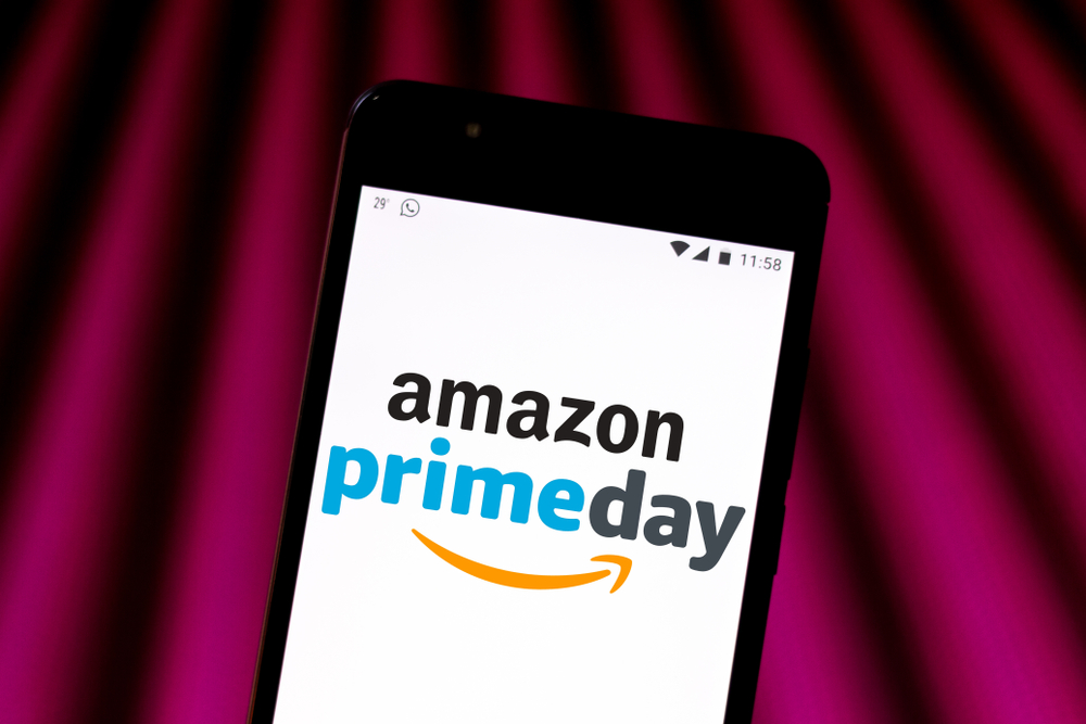 Amazon Prime Day logo is displayed on a smartphone.