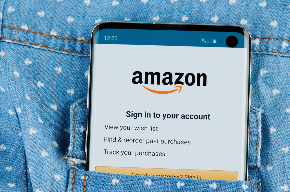 Amazon application on smartphone screen close up view in shirt pocket