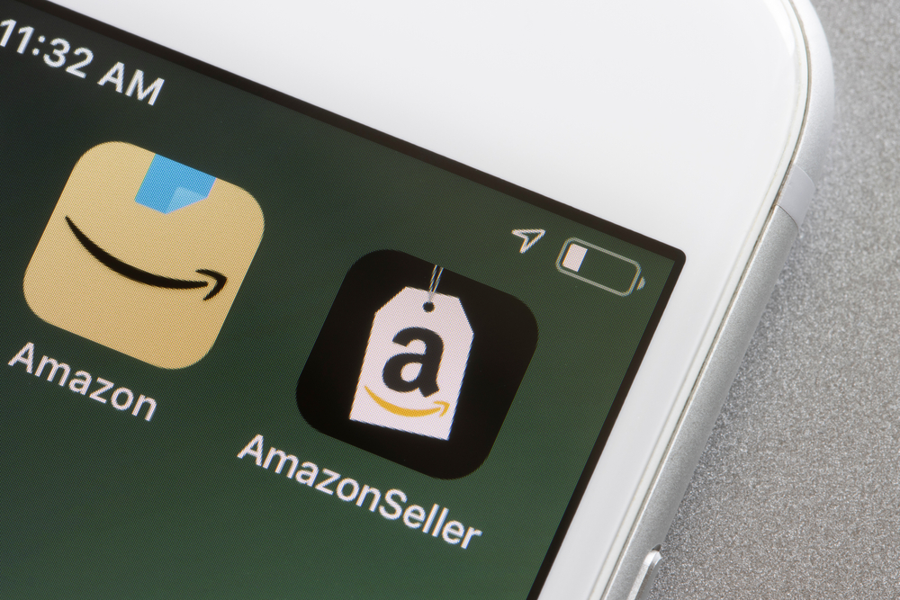 Amazon Seller and Amazon Shopping apps are seen on an iPhone.